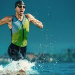 Professional triathlete swimming in river's open water