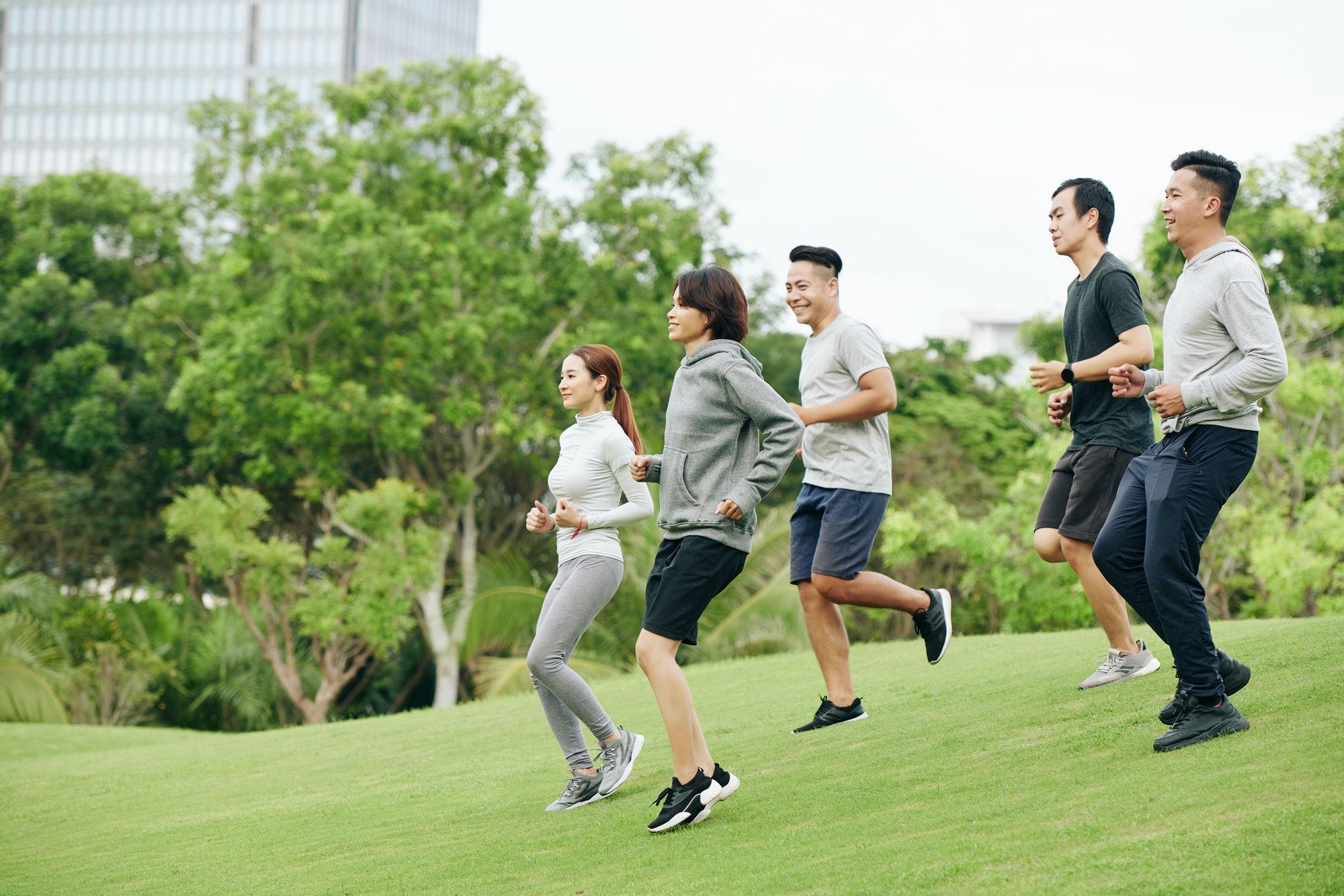 Sportsmen running in park