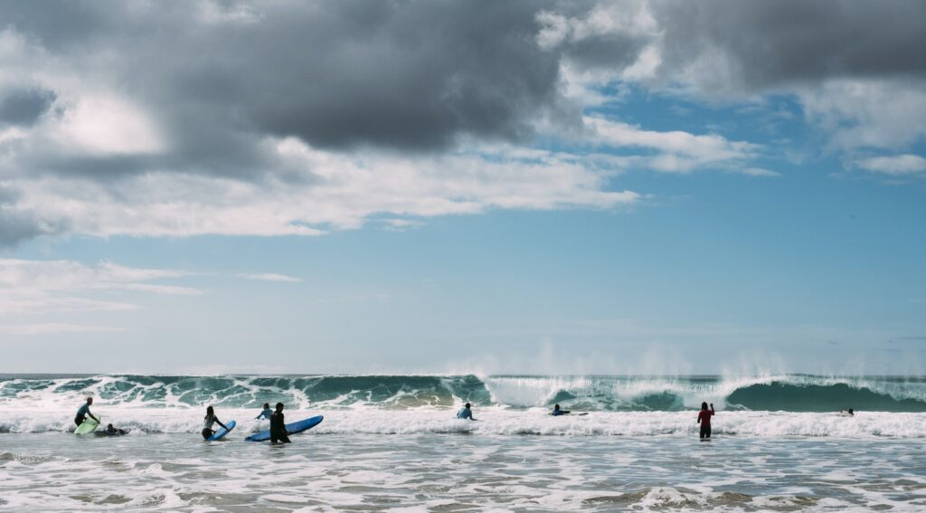 Young men surfing in sea